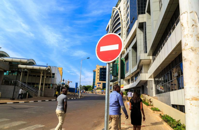 Pedestrians walk through the car free zone at KN Avenue Street in the central Business district Kigali. (Timothy Kisambira)