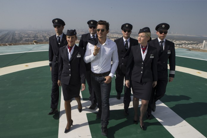 Orlando Bloom surveys the Abu Dhabi cityscape from an inner-city helipad to celebrate British Airways new 787-9 Dreamliner route 2 - Image by Wouter Kingma