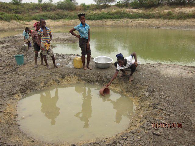 people scooping water