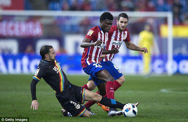 Partey wins a tackle against Jose Ignacio