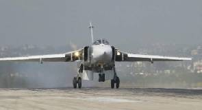 A Sukhoi Su-24 fighter jet lands at the Hmeymim air base near Latakia, Syria, in this handout photo