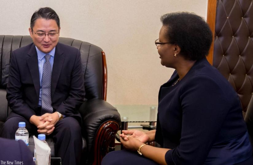 South Korean Ambassodor to Rwanda Park Yong-min (L) in discussion with Speaker Donatille Mukabalisa during his courtesy call on Parliament yesterday. (Timothy Kisambira)
