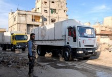 Aid trucks enter the rebel-held town of Douma, east of Damascus, Syria, on Feb. 13, 2016. The aid, delivered by the Syrian Arab Red Crescent(SARC), includes milk for kids, insulin, and other medicine for chronic diseases. (Xinhua/Ammar)