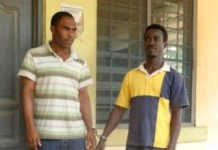 Rexford Agyapong(right)and his accomplice Paul Aben (left) after they were arrested.