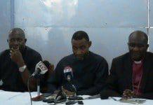 Reverend Dr Lawrence Tetteh (middle) with Right Reverend Samuel Kofi Osabutey (right)