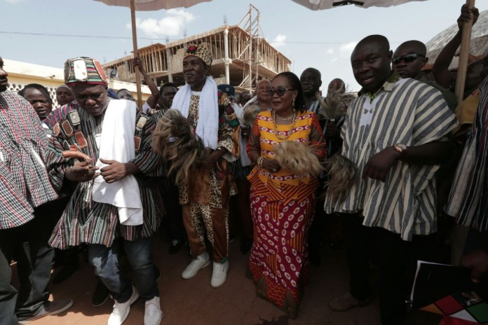 First Lady dancing with some of the Chiefs at the Apoo Festival