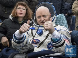 In this photo provided by NASA, International Space Station (ISS) crew member Scott Kelly of the U.S. gestures after landing near the town of Dzhezkazgan, Kazakhstan, on March 2, 2016. [Photo/Xinhua]