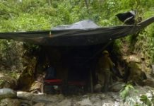 AFP/File / Raul Arboleda Critics point to stagnant water buildups at Colombia's clandestine mining sites and poor sanitary conditions at the workers' camps for an increase in mosquitos spreading
