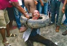 4. A mob setting a young man on fire for allegedly stealing a wallet