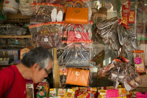 AFP / Aaron Tam Hong Kong is bustling with speciality stores stocking everything from paper false teeth, iPads and shirts, to chauffeur-driven cars