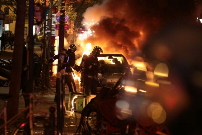 Cars were set alight and clashes erupted as at least 170,000 workers and students took to the streets across France (AFP Photo/Joel Saget)