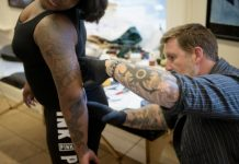 AFP / Brendan Smialowski Nearly half (47 percent) of Americans born in the 1980s and 1990s have at least one tattoo, according to a Harris poll