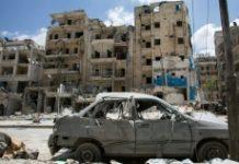 AFP / Karam Al-Masri The damaged Al-Quds hospital building (R), pictured following airstrikes on the rebel-held neighbourhood of Sukkari in Aleppo