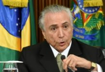 AFP / Evaristo Sa Acting Brazilian President Michel Temer presents his economic measures during a meeting with the leaders of allied parties in Congress at the Planalto Palace in Brasilia on May 24, 2016