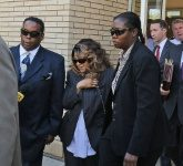 Getty/AFP / Adam Bettcher Tyka Nelson, the sister of Prince, and her attorneys exit the Carver County court house after the first hearing on the musician's estate on May 2, 2016 in Chaska, Minnesot