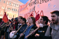 AFP / Louisa Gouliamaki Young people shout slogans during a protest rally against the latest reform measures in front of the Greek parliament building in Athens on May 8, 2016