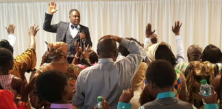Bishop Adonteng with microphone in hand at 1st service of Georgia Duluth USA branch of DWM on May 8, 2016. Photo courtesy theafricandream.net