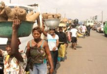 Kayayei on the move at Agbogbloshie market in Accra