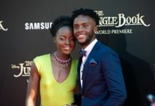 """AFP/File / Valerie Macon Actors Lupita Nyong'o and Peter Nyong'o attend the Disney Premiere of """"The Jungle Book"""" at El Capitan Theater, in Hollywood, California, on April 4, 2016"""