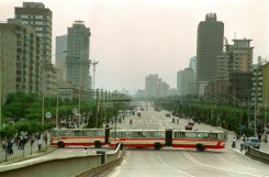 AFP/File / Catherine Henriette Two city buses block Jianguomen Avenue, the main street to Tiananmen Square, on May 21, 1989, in order to keep military forces out after the Martial Law was proclaimed in Beijing the previous day