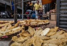 AFP / Anthony Wallace Fish maw drying outside a dried goods store in Hong Kong