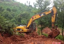 Photo taken on June 26, 2016 shows a landslide happened in a mountain village in Meigu County, southwest China's Sichuan province. [Photo: Chinanews.com]