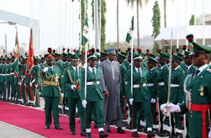 File Photo: President Muhammadu Buhari inspecting the Guards of honour.