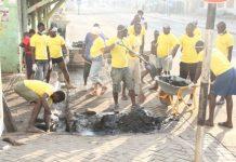 Vivo Energy Ghana Staff and Community Members cleaning their community