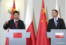 Chinese President Xi Jinping (L) and Polish President Andrzej Duda attend a press conference after their talks in Warsaw, Poland, June 20, 2016. [Photo/Xinhua]
