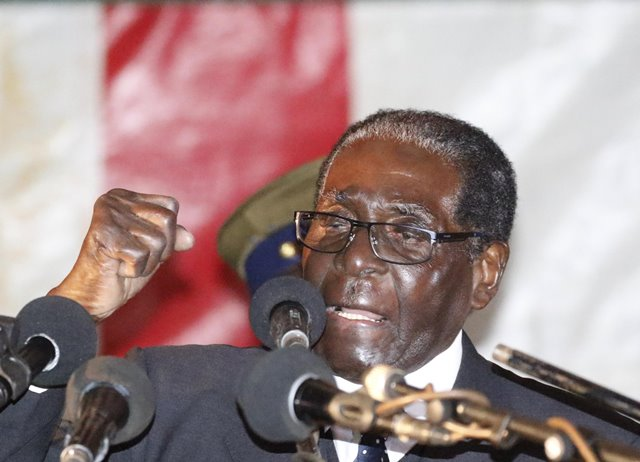 Zimbabwean President Robert Mugabe addresses a gathering at a stadium in the town of Bindura in northern Zimbabwe, July 8, 2016. In his first public appearance after a massive strike over economic deterioration, Mugabe explained to his supporters that the situation was exacerbated by a lasting drought and sanctions of the West. (Xinhua)