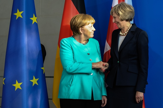 German Chancellor Angela Merkel(L) and British Prime Minister Theresa May attend a press conference after their meeting at the Chancellery in Berlin, Germany, on July 20, 2016. Britain will maintain close economic relations with Germany despite its intention to exit the European Union (EU), Britain's new Prime Minister Theresa May said Wednesday during her visit to Germany. (Xinhua/Guo Yang)