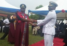 Out-going Commandant Air Vice Marshall (in blue black uniform) handing over the baton to Rear Admiral Amoama (in white).