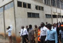 Dr Amo-Mensah taking Dr Vanderpuije round the abandoned project