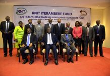 Prime Minister Anastase Murekezi in a group photo with officials attended the launch of Iterambere Fund