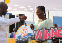 Eugenia Adama receiving her keys to the Range Rover Sports vehicle from Mr Noel Kojo Ganson