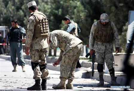 Afghan policemen inspect the site of a blast in Kabul, capital of Afghanistan, on Sept. 8, 2016. One civilian was killed and three others injured as a bicycle bomb planted by militants went off in Kabul on Thursday, police said. (Xinhua/Jawid Omid)