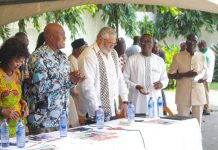 from left to right Mr Kofi Portuphy, NDC, National Chairman, for President Rawlings, Mr Lee Ocran and Alhaji Abdullah, NDC National Treasurer at the extreme right in the picture.