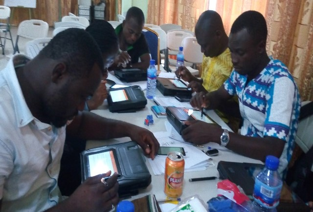 Data entering clerks busily working in Upper West Region, one of the beneficiary regions