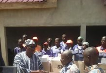 The Paramount Chief of the Bongo Traditional area, Naba Baba Salifu Aleeyaarum , presenting the items to one of the officials of Zoomlion Company Limited
