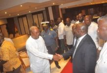 President Mahama (Second from left) and Nana Akufo-Addo (Third from right) in a handshake at the inauguration of the Joint Transition Team in Accra.