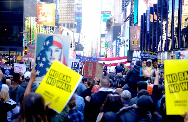Protesters hold placards to demonstrate against U.S. President Donald Trump's immigration policy at Times Square in New York City, the United States, on Feb. 19, 2017. About 1,000 New Yorkers rallied at Times Square, dubbed as the Crossroads of the World on Sunday, to show solidarity with New York City's Muslim community, protesting U.S. President Donald Trump's immigration policy. (Xinhua/Yuan Yue)