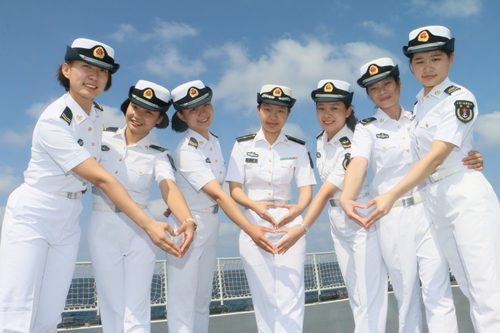 Female sailors pose for photo during a break. (Photo by Li Youtao from People's Daily)
