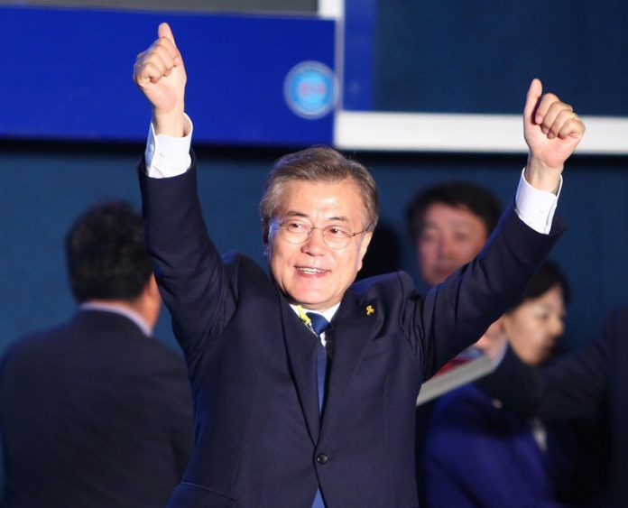 Moon Jae-in of the liberal Minjoo Party waves during a celebration event in Seoul, South Korea, on May 9, 2017. Liberal candidate Moon Jae-in of the Minjoo Party said Tuesday that South Korea's presidential election is