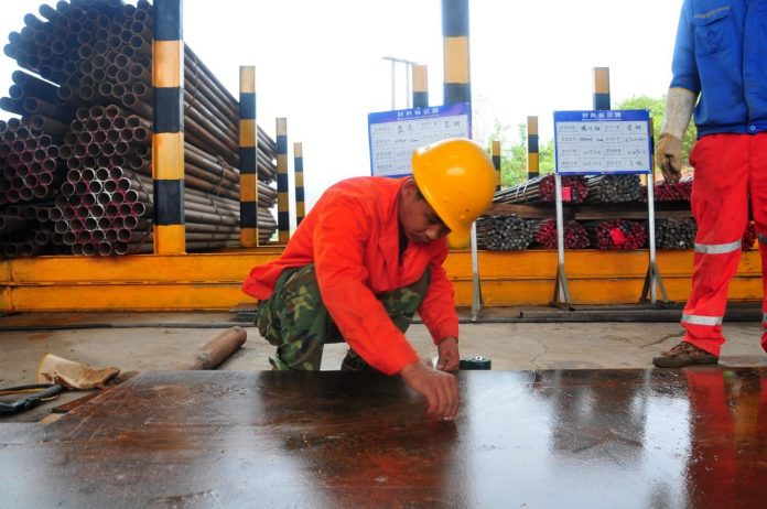 On April 13, 2017, a worker is processing steel at the construction site in the mountainous area of northern Laos' city of Muang Xay, where a tunnel of China-Laos railway project undertaken by China Railway International Group locates. China-Laos railway is the first overseas rail project mainly invested by China, co-operated by both sides and connected to Chinese railway network. The railway applied both Chinese specifications and equipment. (Photo by Xinhua News Agency)