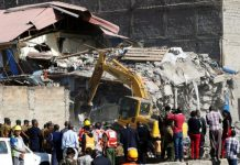 Reuters Image caption Witnesses said the building had been condemned