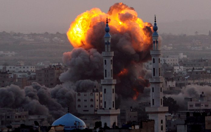 Smoke rises after an Israeli air strike on an allegerd Hamas site in the south east of Gaza City, Gaza Strip, 17 November 2012. Israel has put 75,000 reservists on standby amid speculation of an impending ground invasion. EPA/MOHAMMED SABER