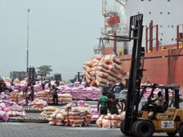 Workers unload bags of rice on January 19, 2011 at the Port of Abidjan where 80% of Ivory Coast's exports transit. EU-registered ships have been barred from dealing with Ivory Coast's main cocoa ports in line with sanctions over the nation's controversial November presidential poll. The European Union last weekend slapped sanctions on outcast incumbent leader Laurent Gbagbo and 84 of his associates, as well as 11 economic entities in the world's top cocoa producer. AFP PHOTO/ ISSOUF SANOGO (Photo credit should read ISSOUF SANOGO/AFP/Getty Images)