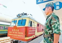 A train numbered 9001 is ready to leave Khorgos for Astana, capital of Kazakhstan, June 8 (Photo by Xinhua)