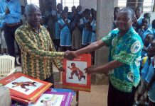 Mr. Anthony Amoah (R) presenting the books to Mr. Samuel Duame (L)