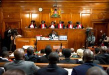 Kenyan Supreme Court judges, from left to right, Njoki Ndung'u, Jackton Ojwang, Deputy Chief Justice Philomela Mwilu, Chief Justice David Maraga, Smokin Wanjala and Isaac Lenaola preside over the second day of hearings of a petition challenging the presidential election result, at the Supreme Court in Nairobi, Kenya Tuesday, Aug. 29, 2017. Kenya's Supreme Court is hearing veteran opposition leader Raila Odinga's challenge to President Uhuru Kenyatta's re-election earlier this month. Sayyid Azim AP Photo